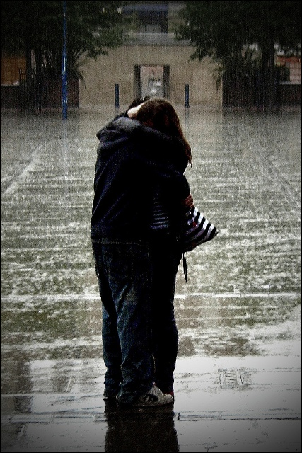 kissing in rain. couple kissing in the rain