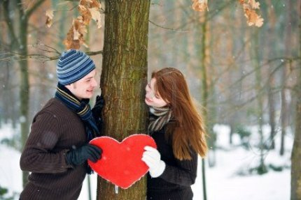 6384835-couple-with-red-heart-smiling