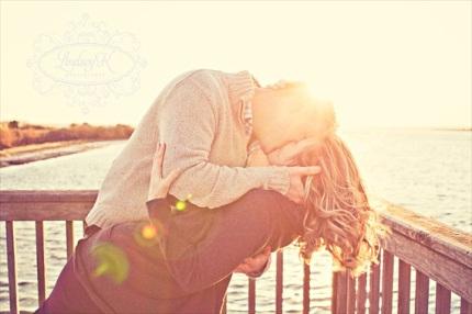 couple-kissing-sunset-engagement