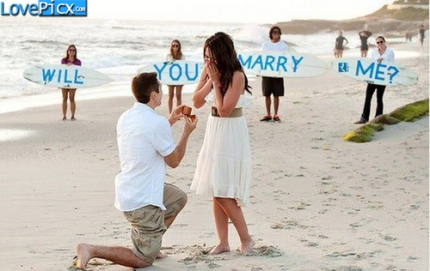 proposing-boy-girl-will-you-marry-me-beach_large