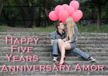 young loving couple with red balloons on natural background